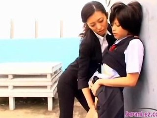 Schoolgirl Kissing Fingered By Office Lady On The Roof