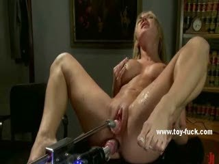 Busty light-complexioned sitting on a chifferobe squirts after mammal pumped by toys