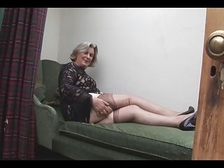 Busty Granny Shows Off Hairy Pus...