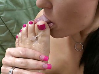 Dirty bitch licks the cum off her feet after foot wanking prick