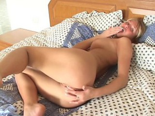 Horny Blonde Teen Rubs Her Shaved Pussy On Her Bed