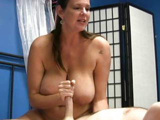 Mature gives him a collar and chatty handjob