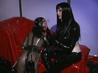 Anastasia Pierce Has Fun With Her Rubber Slave