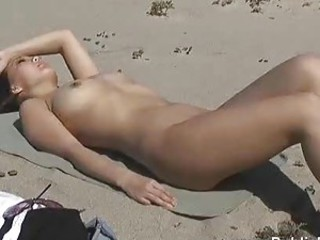 Nude and happy on a public beach