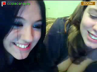 Two young brunette teens set up their webcam an show off their big boobs