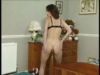 Young brunette, Shakina Shergold strips and then fucks her bedpost and dildo