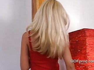 Gorgeous blonde pornstar in hot red dress strips and teases