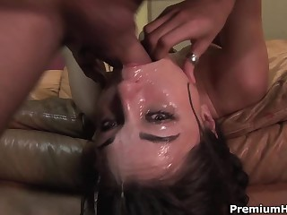 Well known dark-haired haired porn diva Sasha Grey gets her throat fucked extremely deep. She gets a mouthful of jizz after rough face fucking on the couch.