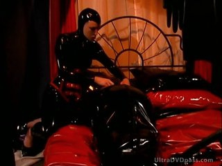 Kinky Latex-Loving Dominatrix Spanks Her Submissive Lesbian Slave's Round Ass
