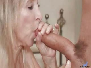 Horny blonde granny slurps on a young cock then gets pounded in her pussy