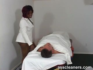 Chubby ebony doctor smothers a complaining patient by sitting on his face so he can talk no more