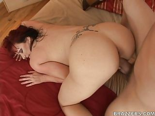 Hot redhead Kylie Ireland gets her rounded butt rammed hard doggystyle