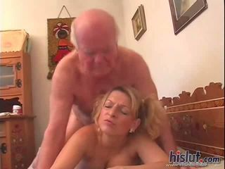 This slut is pleasuring an old guy