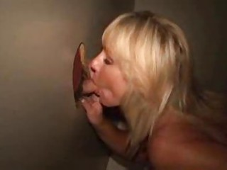 Tantalizing blonde plays with gloryhole cock