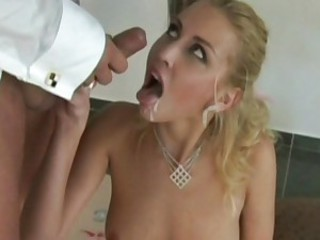 Sexy blond Julie Silver getting her pretty mouth slimed with hot jizz