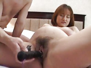 Pregnant Asian taking toys in her pussy