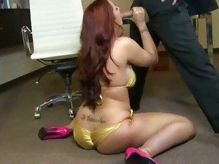 Hot red-haired busty woman Kelly Divine in pink high heels enjoys stiff dick in her mouth before she spreads her legs for man and pulls her panties aside to be licked. She loves oral sex so much.