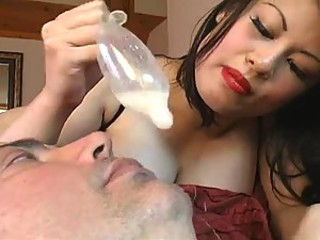 Mistress cucks man and pours cum on his manifestation