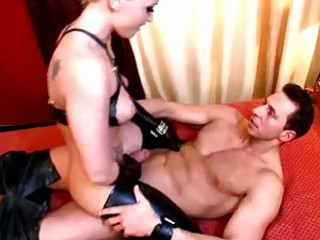 Kinky babe Kathia Nobili in leather fucking cock