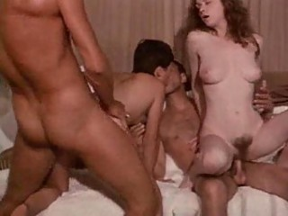 Vintage group sex scene with hairy pussies