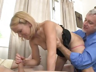 Cute blonde Jennifer Dark gets tag teamed by old and young guys. She takes young dick in her mouth as older man pleases her pussy from behind. That's the experience she won't soon forget.