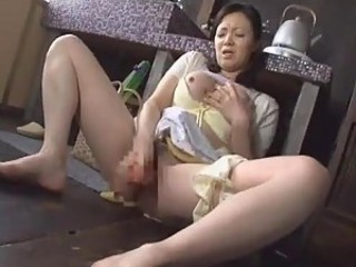 Asian girl fucks pussy with a carrot