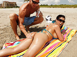Diamond is at the beach and needs some assistance to oil up her ass so she can get a nice tan. She calls over Johnny to oil her up, but he ends up going over to her place and rubbing his special cream