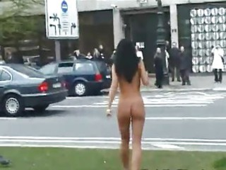 Girl walks around busy city streets naked