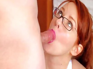 Sexy redhead gives a sensual blowjob