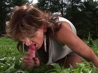 Tanned granny slams her bald pussy on an eager cock loving it outdoor