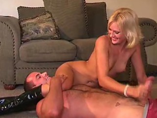 Dominant boots girl strokes his chunky cock