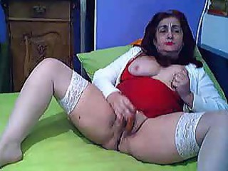 Greek grandmother in sexy white stockings rubs her old pussy