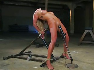 Pretty whore gets tied up and tortured with a toy on her trembling twat