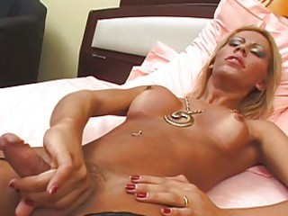 Shemale hottie plays with her cock while debilitating leather boots with respect to bed