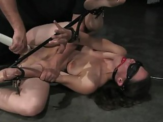 Bondage girl double dildo fuck on floor