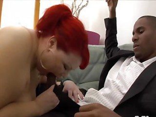 Red headed whore takes a dark dick deep in her fucking throat until she chokes