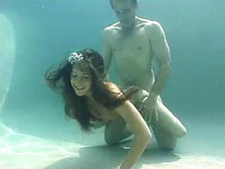 Young chick gets fucked underwater