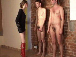 Consumptive blonde dominatrix whips and slaps two submissive dudes