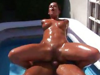 Girl covered in oil having hardcore sex outdoors