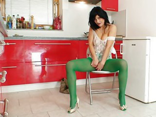 Masturbating in her green pantyhose