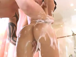 Wet Brunette Gets A Double Penetration In The Bathroom