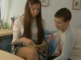 Cute little hottie is doing homework with her classmate.