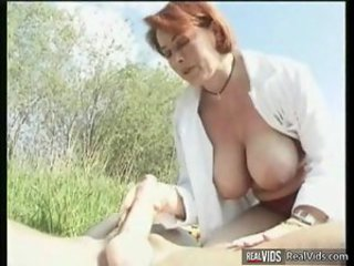 Plump mama riding cock in the sun