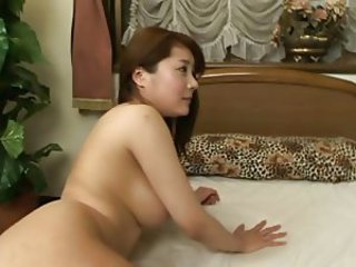 Busty Japanese babe gives cunt