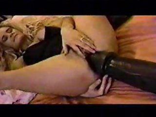 Girl plays with giant dildos