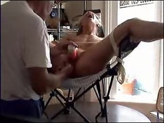 Tied amateur in chair has pussy toyed