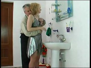 Older man fucks girl in shiny silver dress
