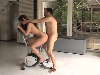 Fucked as she rides the exercise bike
