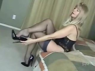 Adult in hot stockings sucks on flannel
