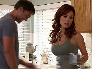 Busty redhead gets her...